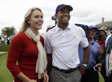 United States team player Tiger Woods smiles with girlfriend Lindsey Vonn after US won the Presidents Cup golf tournament.