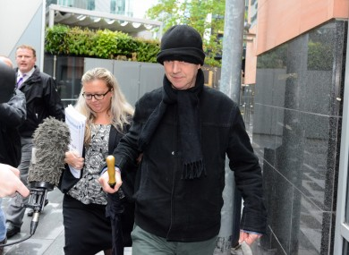 Ray Teret, seen here in black hat, is charged with 32 offences against 15 alleged victims.
