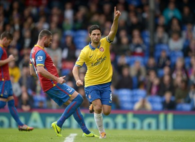 Arsenal's Mikel Arteta celebrates after scoring his team's opening goal from the penalty spot.