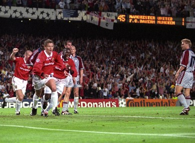 Ole Gunnar Solskjaer celebrates scoring the winning goal, chased by teammates Jaap Stam and Dwight Yorke.