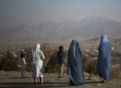 Afghan women with their children enjoy a view over Kabul, Afghanistan.