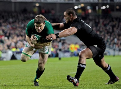 Brian O'Driscoll scores a try after a wonde