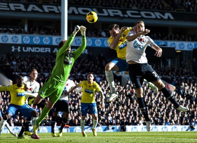 Tim Krul punches clear.