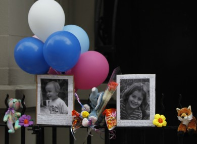 Photographs of Leo and Lucia Krim at a memorial outside the apartment building were they lived in New York.