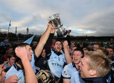 David Breen lifts the cup with his Na Piarsaigh teammates.
