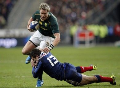 France's Florian Fritz, right, tackles South Africa's Jean de Villiers.