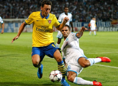 Mesut Ozil and Jeremy Morel when Arsenal faced Marseille at the start of the season.