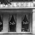 In this picture, the word Jude (jew) is smeared to the windows of a shop in Berlin run by Jews. <span class=