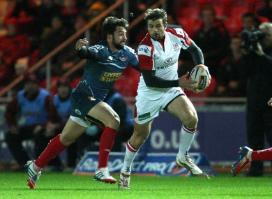 Ulster's Jared Payne is tackled by Gareth Owen of Scarlets.
