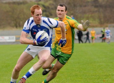 Clancy in action against Neil McGee of Donegal.