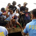 Residents living near the slopes of Mayon volcano are evacuated.<span class=