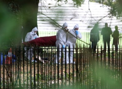 The body of the man is removed from where it was found on fire near the Wellington Monument in Phoenix Park, Dublin.
