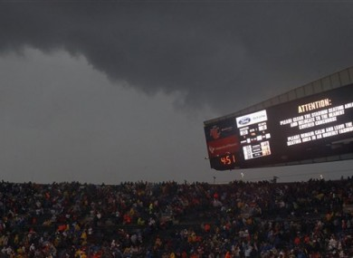 Fans are warned to take cover as a severe storm moves through Soldier Field during the first half of an NFL football game between the Chicago Bears and Baltimore Ravens.