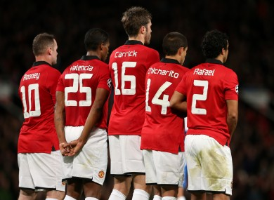 Michael Carrick in the centre of a Manchester United defensive wall.