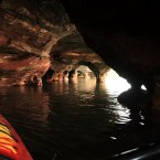 Kayak through the Apostle Islands, off the Wisconsin shore of Lake Superior. The group of 22 islands is riddled with caves, and during the winter visitors can see frozen waterfalls and icicle-filled chambers.<span class=
