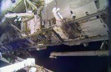 Spacewalking astronauts make speedy station repairs