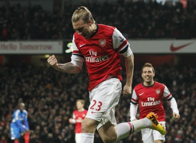 Bendtner celebrates his goal last night.