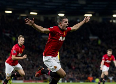 Van Persie celebrates scoring against Arsenal earlier this season.