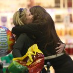 iara Meyler from Wexford (left) is welcomed home from Perth for Christmas by her sister Aisling<span class=
