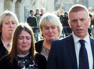 Rebecca Rigby (second left), the wife of murdered Lee Rigby, weeps as a statement is read out by Detective Inspector Pete Sparks (right) outside the courthouse.