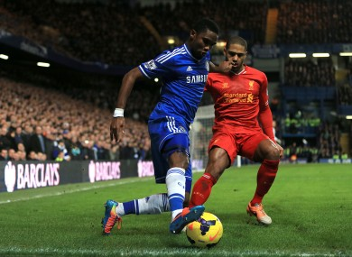 Chelsea's Samuel Eto'o (left) and Liverpool's Glen Johnson (right) in action.