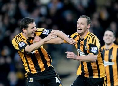 Alex Bruce and David Meyler celebrate: Hull beat Liverpool 3-1 at the start of December.