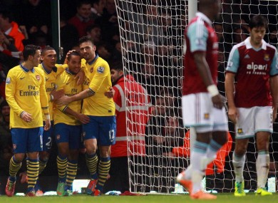 Arsenal players congratulate Walcott.