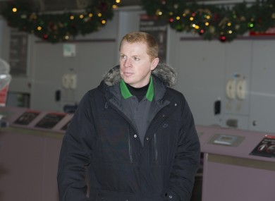 Celtic manager Neil Lennon at Glasgow Airport ahead of their Champions League tie.