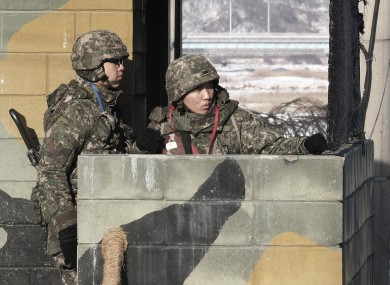 South Korean army soldiers stand guard at a military checkpoint near the border village of Panmunjom