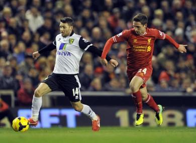 Hoolahan is chased by Liverpool's Joe Allen.