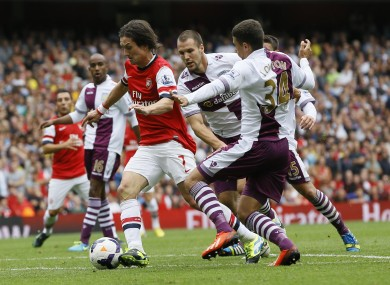 Tomas Rosicky is closed down by Ron Vlaar and Matt Lowton back in August.