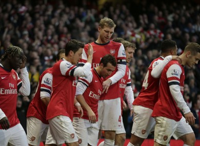 Arsenal's Santi Cazorla, centre, celebrates scoring his side's first goal with his teammates.