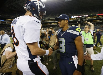 Petyon Manning and Russell Wilson will battle it out for the Super Bowl next week.