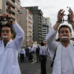 Doctors and medical students protest against a new law criminaliSing medical malpractice in Quito, Ecuador. Doctors nationwide have threatened to resign their positions at public hospitals.<span class=
