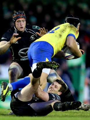 Connacht's Eoin McKeon and Jack Carty tackles Gonzalo Garcia of Zebre.