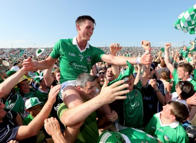 Limerick's Gavin O'Mahony is carried by fans after winning the Munster final.