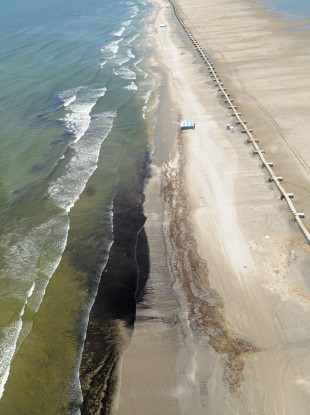 Crude oil washes up onto Fourchon Beach in the US in 2010.