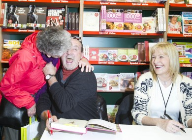 Mary Connor from Dun Laoghaire gives Brendan O'Carroll a kiss in Eason O'Connell Street.