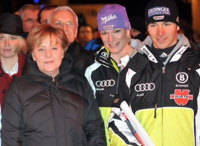 Angela Merkel, left, with two German skiers at the Alpine Skiing World Championships in 2011.