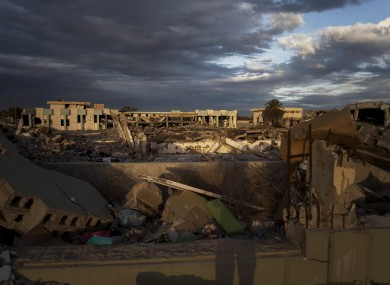 File: Buildings destroyed in the Bab al-Aziziya compound and an occupied intact building in Tripoli, Libya.