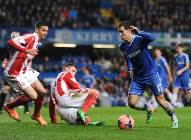Eden Hazard goes past two Stoke defenders.