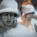The Korean War Memorial in Washington is covered with snow following a storm. <span class=