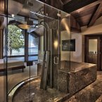 ...an all-glass shower designed to extend the master bedroom's lake views into the bathroom. Ms. Mansouri calls this her