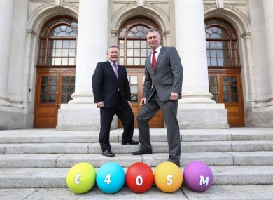 Minister Brendan Howlin on the ball today with CEO of Premier Lotteries Ireland, Dermot Griffin.
