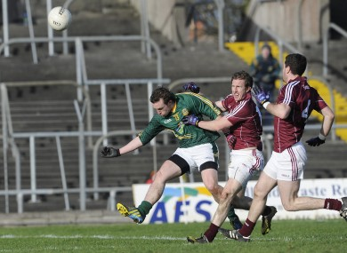 Meath's Eamonn Wallace in action against Galway's Gary Sice.