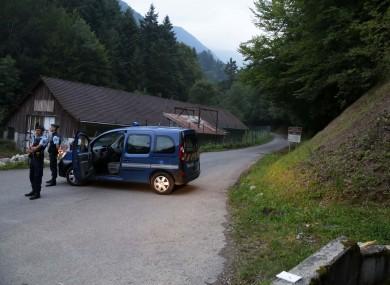 Gendarmes block access to the crime scene near Chevaline in 2012