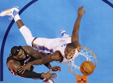 Miami Heat forward LeBron James (6) dunks in front of Oklahoma City Thunder forward Serge Ibaka.