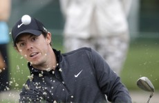 McIlroy clings to PGA lead while Tiger makes cut