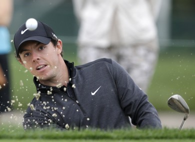 Rory McIlroy hits out of a sand trap on the 13th hole during the second round of the Honda Classic golf tournament.