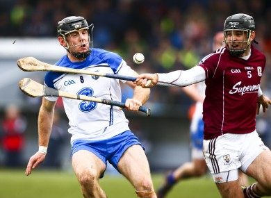Waterford's Kevin Moran and Galway's David Collins.
